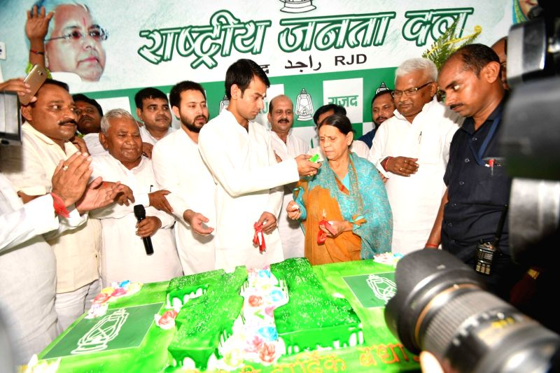 RJD leaders Rabri Devi, Tej Pratap Yadav and Tejaswi Yadav along with party workers celebrate the 71st birthday of former Bihar Chief Minister and RJD chief Lalu Prasad, in Patna on June 11, ... - Tej Pratap Yadav and Tejaswi Yadav