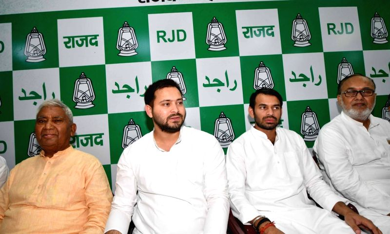 RJD leaders Tej Pratap Yadav and Tejaswi Yadav and other leaders during a meeting of the party MLAs in Patna on July 19, 2018. - Tej Pratap Yadav and Tejaswi Yadav