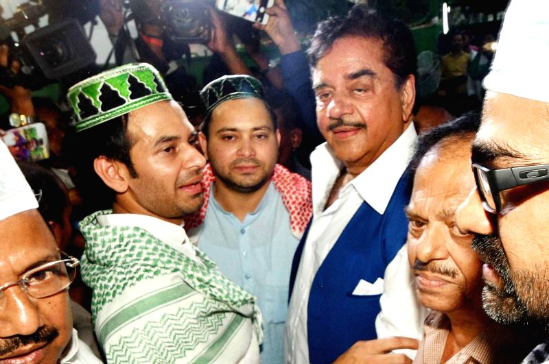 RJD leaders Tejashwi Yadav and Tej Pratap Yadav with actor turned politician Shatrughan Sinha during an iftaar party at their residence in Patna, on June 13, 2018. - Tejashwi Yadav, Tej Pratap Yadav and Shatrughan Sinha