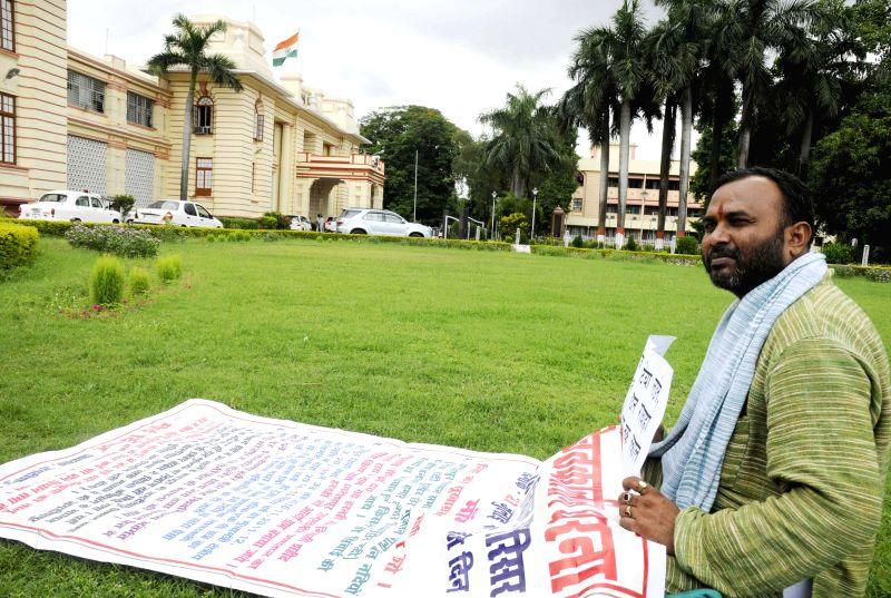 RJD legislator Dinesh demonstrates at Bihar Legislative Assembly premises in Patna on July 21, 2014.