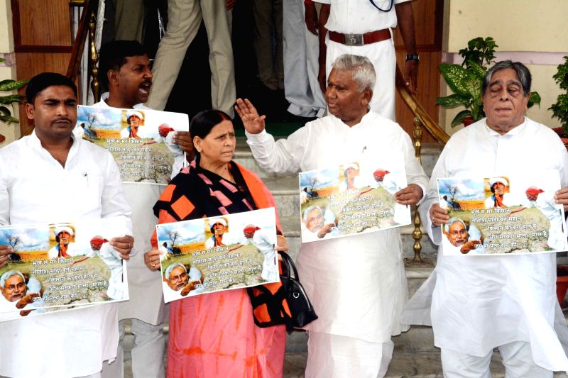 RJD legislators led by party leader Rabri Devi stage a demonstration against Prime Minister Narendra Modi and state's Chief Minister Nitish Kumar, in Patna on July 23, 2018. - Narendra Modi and Nitish Kumar