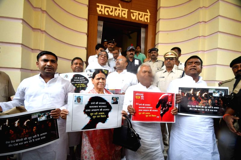 RJD legislators led by Rabri Devi stage a demonstration at Bihar Legislative Assembly, in Patna on July 24, 2018.