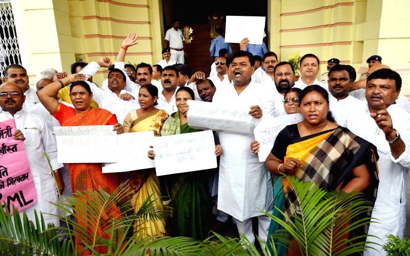 RJD legislators stage a demonstration outside the Bihar Legislative Assembly, in Patna on July 26, 2018.