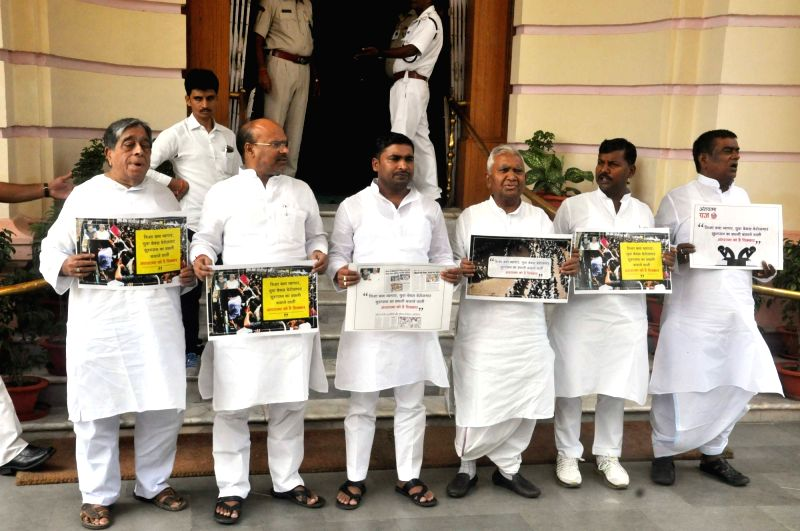 RJD legislators stage a demonstration over Bihar's education system, outside Bihar Legislative Assembly, in Patna on July 25, 2018.