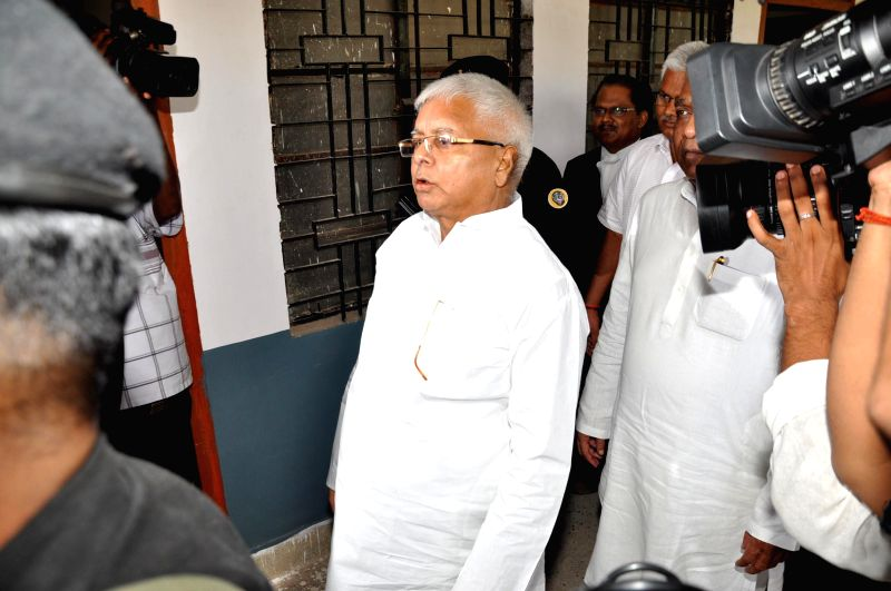 RJD supremo and and former Bihar Chief Minister Lalu Prasad Yadav arrives to appear in front of a CBI Court in Ranchi to record his statement in a fodder scam case on July 14, 2014. - Lalu Prasad Yadav