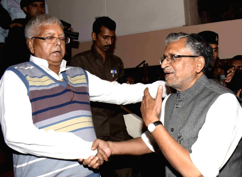 RJD supremo Lalu Prasad Yadav and BJP leader Sushil Kumar Modi during a programme in Patna on Nov 30, 2015. - Lalu Prasad Yadav and Sushil Kumar Modi