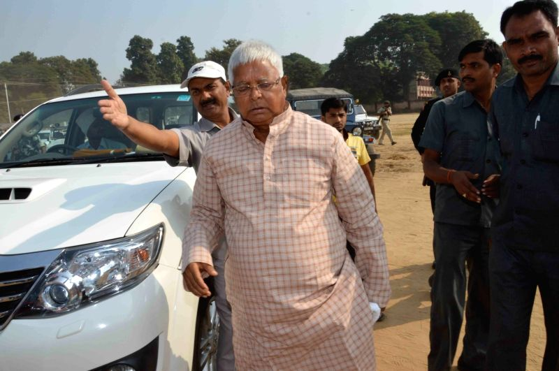 RJD supremo Lalu Prasad Yadav arrives to cast his vote during the third phase of Bihar assembly polls in Patna on Oct 28, 2015.