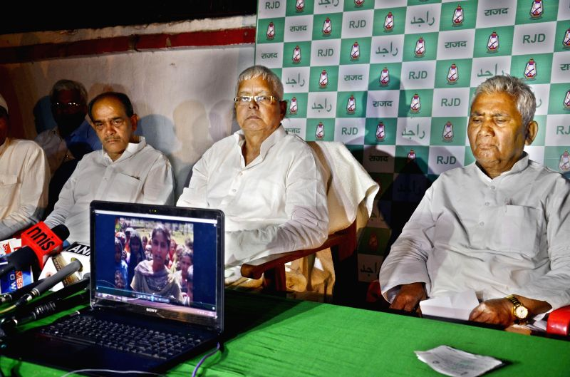 RJD supremo Lalu Prasad Yadav during a press conference where he showed a video recording of discrepancies in a polling booth of Gaya, in Patna on April 11, 2014.