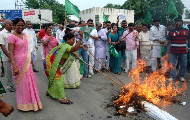 RJD workers burn effigies of  Union Railway Minister D.V. Sadananda Gowda and Prime Minister Narendra Modi against Rail budget 2014-15 which was presented in the Parliament by Railway Minister, in ... - D. and Narendra Modi