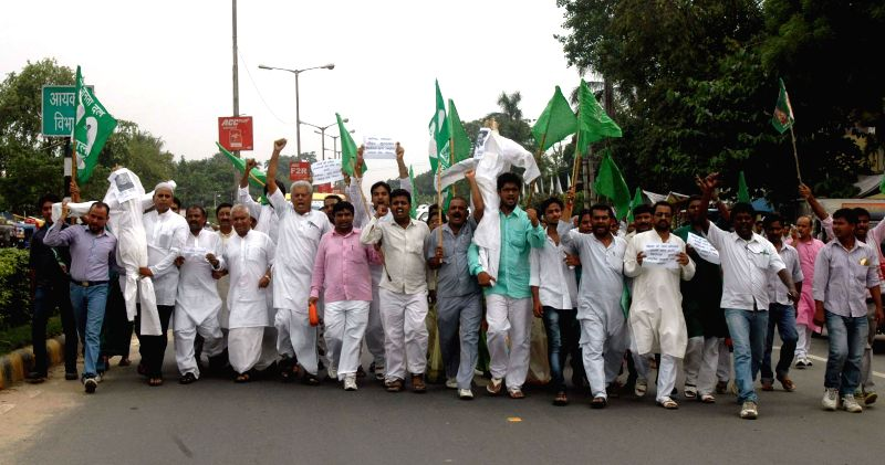 RJD workers demonstrate against Rail budget 2014-15 which was presented in the Parliament by Union Railway Minister D.V. Sadananda Gowda, in Patna on July 8, 2014. - D.