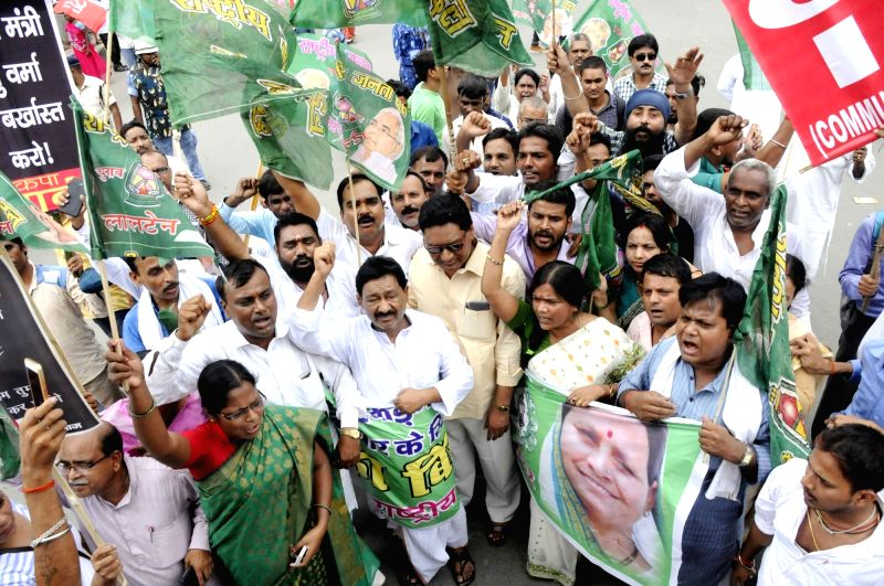 RJD workers stage a demonstration during a shutdown called by the Left parties in Bihar against the rape of 34 minor girls at a shelter home in Muzaffarpur district; in Patna on Aug 2, 2018. ...
