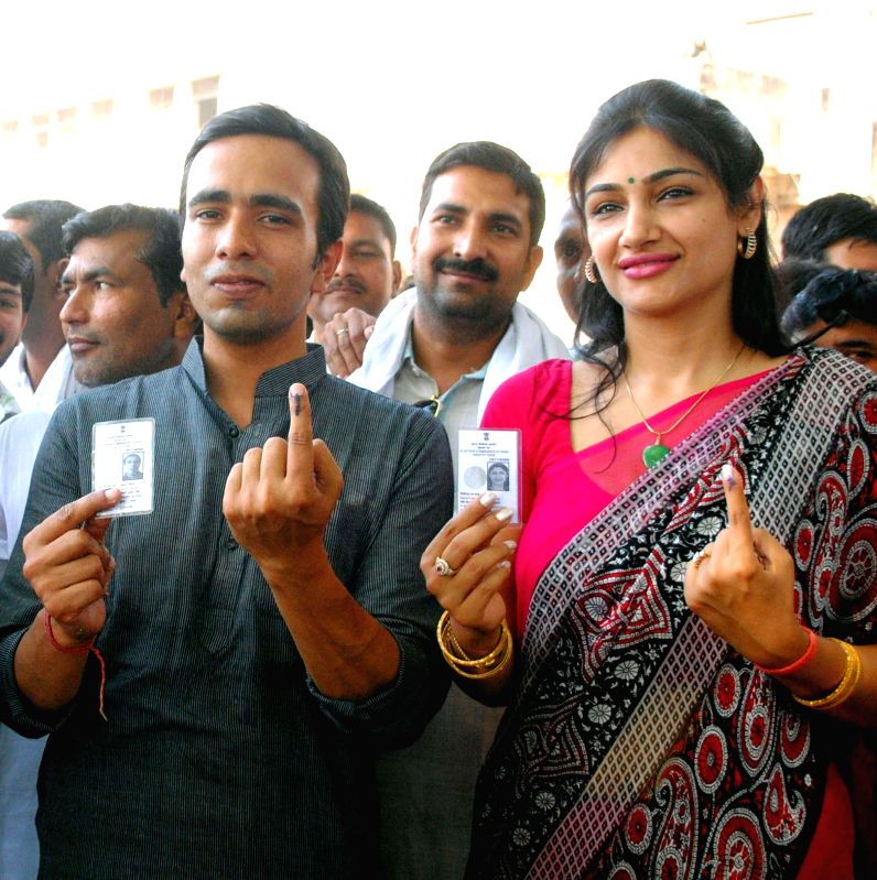 RLD candidate for 2014 Lok Sabha Election from Mathura Lok Sabha Seat, Jayant Chaudhary shows his fore finger marked with phosphorous ink after casting his vote at a polling booth during the sixth ...
