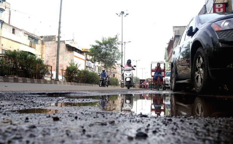 Roads across the city were damaged due to heavy rains in New Delhi on Aug. 6, 2016.