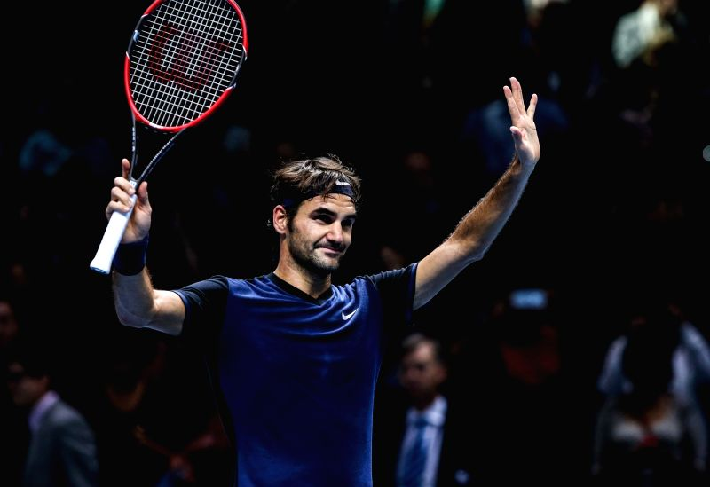 Roger Federer of Switzerland celebrates his victory over Kei Nishikori of Japan during a men's singles group stage match at the ATP World Tour Finals in London, ...