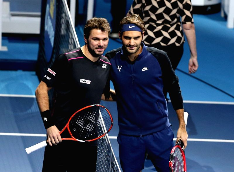 Roger Federer (R) of Switzerland and Stan Wawrinka of Switzerland pose before their semifinal match at the ATP World Tour Finals in London, Britain, Nov. 21, 2015. ...