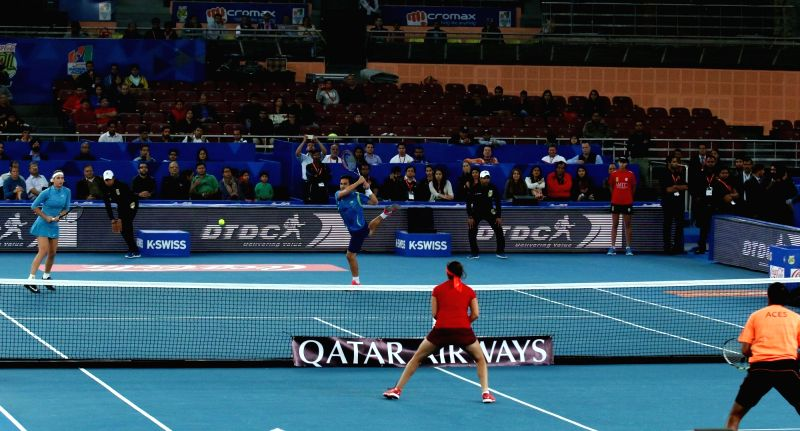Rohan Bopanna and Sania Mirza in action against Treat Huey and Ajla Tomljanovic during an IPTL match between Micromax Indian Aces and Philippine Mavericks at Indira Gandhi Stadium in New ... - Rohan Bopanna, Sania Mirza and Indira Gandhi Stadium
