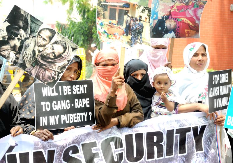 Rohingya Muslim from Myanmar demonstrate to protest against crime against humanity at Jantar Mantar in New Delhi on May 7, 2014.