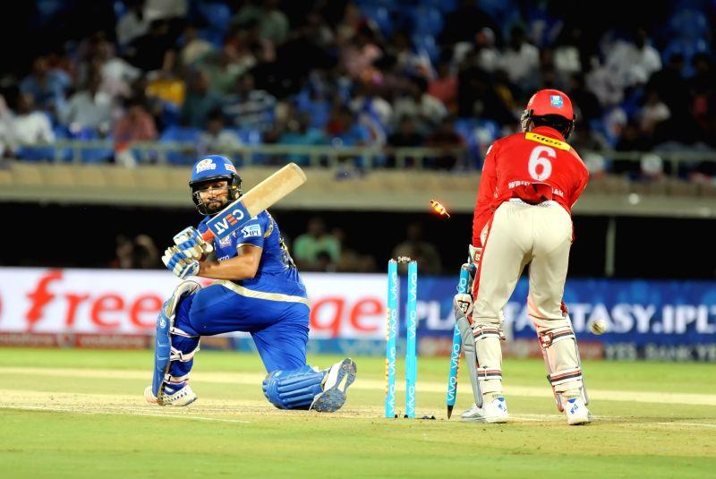 Rohit Sharma of Mumbai Indians gets dismissed during an IPL match between Mumbai Indians and Kings XI Punjab at Dr YS Rajasekhara Reddy ACA-VDCA Cricket Stadium in Visakhapatnam on May ... - Rohit Sharma and Rajasekhara Reddy A