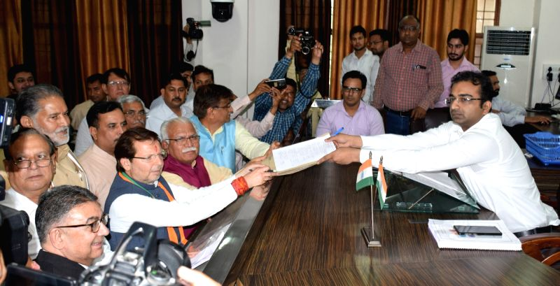 Rohtak: BJP's Lok Sabha candidate from Rohtak, Arvind Sharma accompanied by Haryana Chief Minister Manohar Lal Khattar, files his nomination for the 2019 Lok Sabha elections, in Haryana's Rohtak on April 22, 2019.