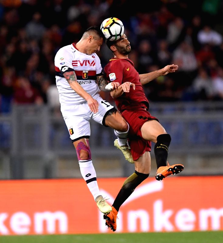 ROME, April 19, 2018 - Genoa's Gianluca Lapadula (L) competes with Roma's Maxime Gonalons during a Serie A soccer match between Roma and Genoa in Rome, Italy, April 18, 2018. Roma won 2-1.