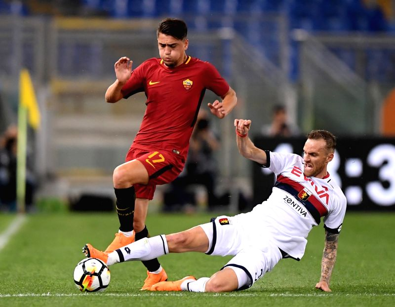 ROME, April 19, 2018 - Roma's Cengiz Under (L) competes with Genoa's Luca Rigoni during a Serie A soccer match between Roma and Genoa in Rome, Italy, April 18, 2018. Roma won 2-1.