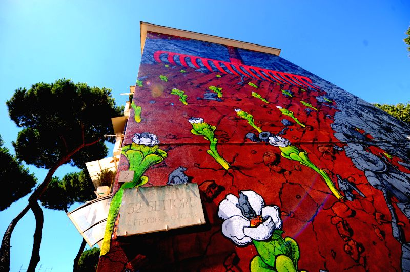 Photo taken on July 15 shows the mural created by Spanish muralist Liqen in San Basilio cummunity of Rome, Italy. Italian capital Rome has launched a project to turn ..