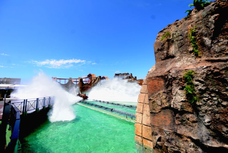 Visitors enjoy their times at Cinecitta World theme park in Rome on July 24, 2014. Italy's first film theme park--Cinecitta World theme park was opened on Thursday. ...