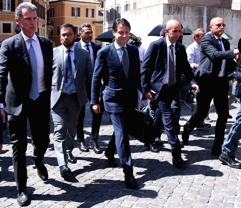 ROME, June 1, 2018 - Italian Prime Minister-designate Giuseppe Conte (C) arrives at Montecitorio Palace to meet with Lower House Speaker Roberto Fico, in Rome, June 1, 2018. - Roberto Fico