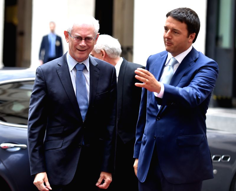 Italy's Prime Minister Matteo Renzi (R) talks with visiting European Council President Herman Van Rumpuy at the Palazzo Chigi in Rome, Italy, June 18, 2014.  ...