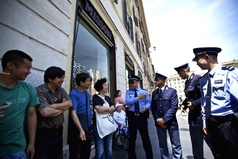 ROME, June 5, 2017 - Chinese police officers and Italian police officers talk with tourists at Piazza di Spagna of Rome, Italy, on June 5, 2017. A joint policing project between China and Italy was ...