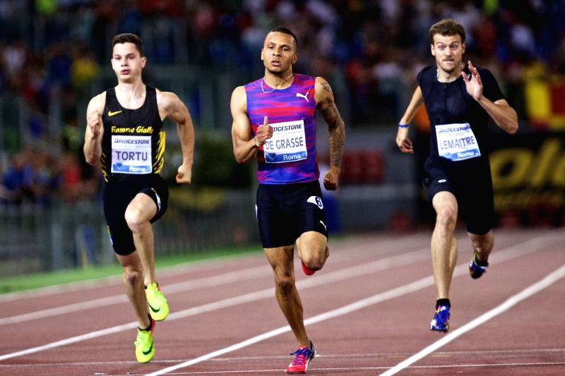 ROME, June 9, 2017 - Andre De Grasse (C) of Canada sprints during the men's 200m event at the Rome's Golden Gala Pietro Mennea, part of IAAF Diamond League competition in Rome, Italy, June 8, 2017. ...