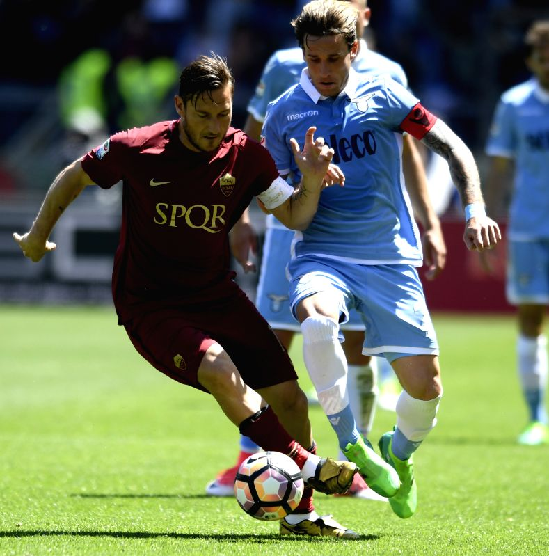 ROME, May 1, 2017 - Roma's Francesco Totti (L) competes with Lazio's Lucas Biglia during a Italian Serie A soccer match in Rome, Italy, April 30, 2017.