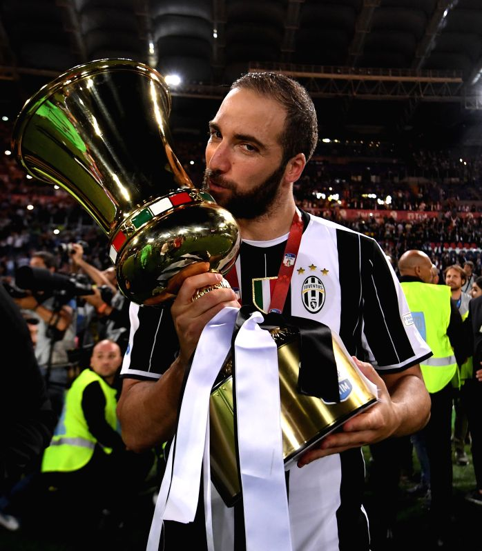 ROME, May 18, 2017 - Gonzalo Higuain of Juventus kisses the trophy after winning the Italian Cup final between Juventus and Lazio in Rome, Italy, on May 17, 2017. Juventus claimed the title with 2-0.