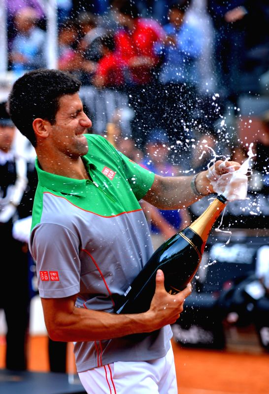Novak Djokovic of Serbia sprays champagne during the awarding ceremony after the men's singles final match against Rafael Nadal of Spain at the Rome Masters tennis ...