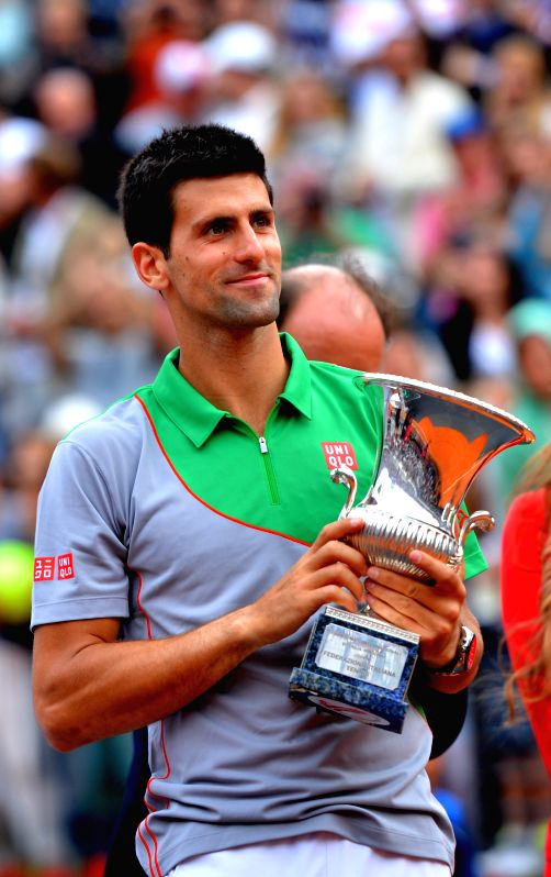 Novak Djokovic of Serbia poses with his trophy during the awarding ceremony after the men's singles final match against Rafael Nadal of Spain at the Rome Masters tennis