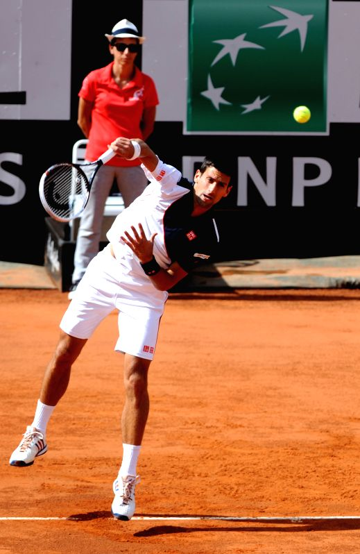 Novak Djokovic of Serbia serves to Rafael Nadal of Spain during their men's singles final match at the Rome Masters tennis tournament in Rome, Italy, May 18, 2014. ...