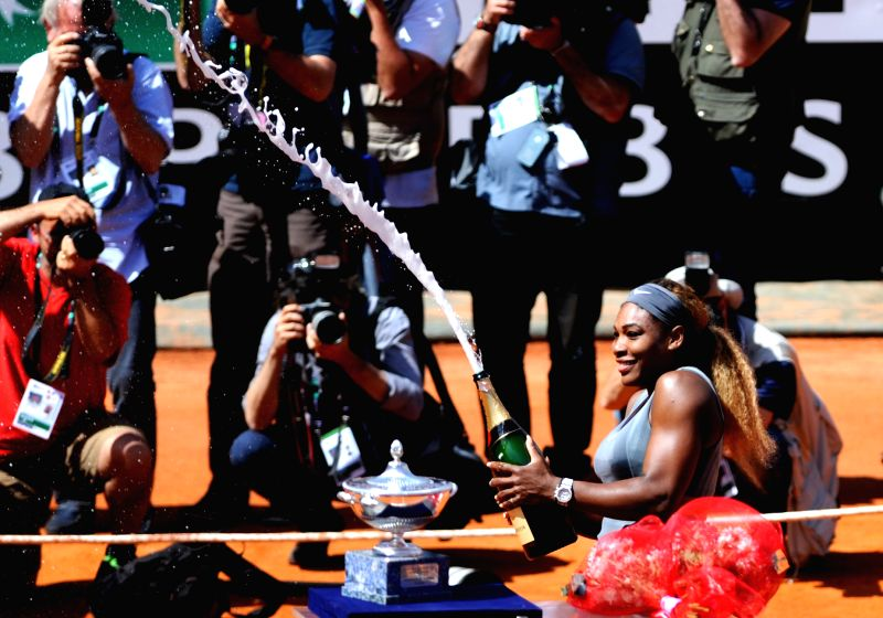 Serena Williams of the United States sprays champagne to celebrate her victory after the women's singles final match against Sara Errani of Italy at the Rome Masters ...
