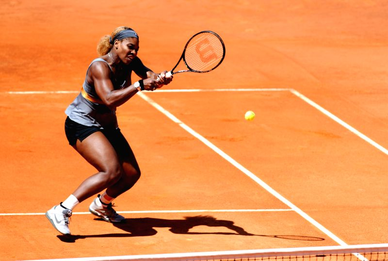 Serena Williams of the United States hits a return to Sara Errani of Italy during their women's singles final match at the Rome Masters tennis tournament in Rome, ...