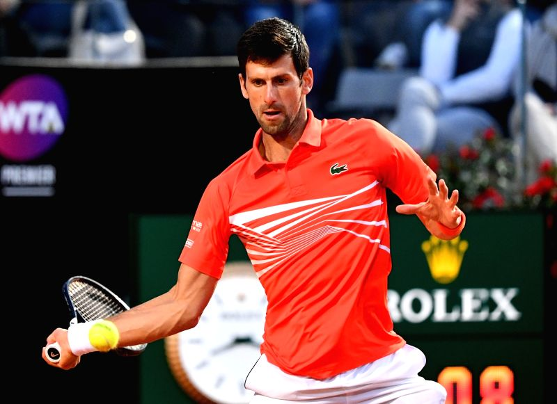 ROME, May 19, 2019 (Xinhua) -- Novak Djokovic of Serbia returns the ball during the men's singles semifinal match against Argentina's Diego Schwartzman at the Italian Open Tennis tournament in Rome, Italy, on May 18, 2019. Novak Djokovic won 2-0. (Xi