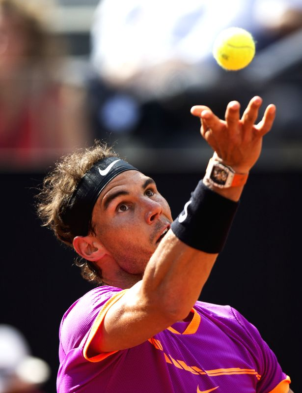 ROME, May 20, 2017 - Rafael Nadal of Spain serves to Dominic Thiem of Austria during the quarterfinal match of men's singles at the Italian Open tennis tournament in Rome, Italy, May 19, 2017. Nadal ...