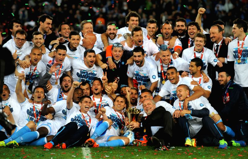 Players of Napoli pose with the trophy after the final match against Florentina at the Italian Cup in Rome, Italy, May 3, 2014. Napoli won 3-1 to claim the champion.