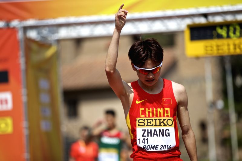 ROME, May 7, 2016 - China's Zhang Jun celebrates after the 10km U20 race final for men at the IAAF World Race Walking Team Championships in Rome, Italy, May 7, 2016. Zhang Jun claimed the title with ...