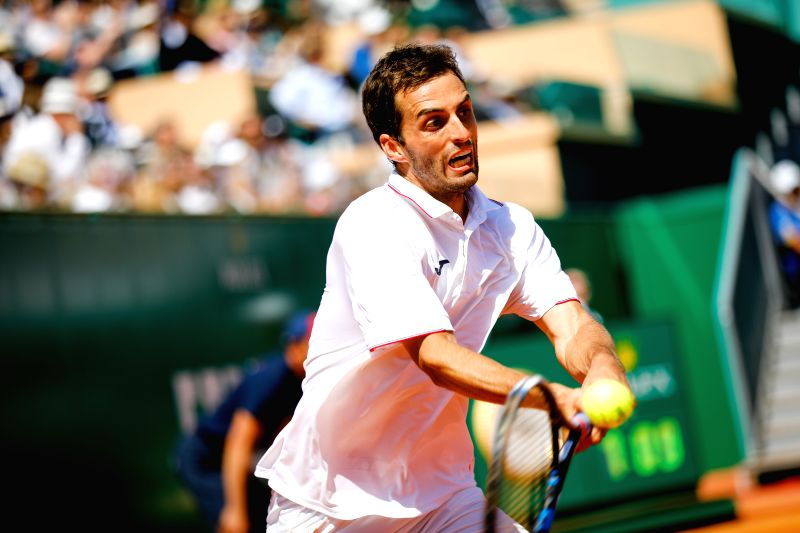 ROQUEBRUNE-CAP-Albert Ramos-Vinolas of Spain returns the ball to Lucas Pouille of France during their semifinal match at the ATP World Tour Masters Monte Carlo in ...