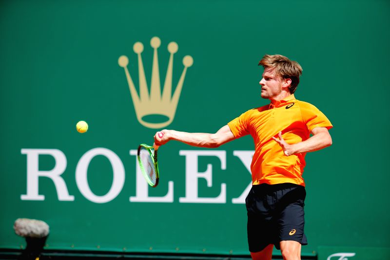 ROQUEBRUNE-CAP-David Goffin from Belgium returns the ball against Dominic Thiem from Austria during the third round match of Monte Carlo masters held in ...