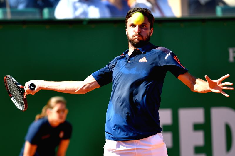 ROQUEBRUNE-CAP-Gilles Simon of France returns the ball during the first round match of 2017 Monte-Carlo Masters against Malek Jaziri of Tunisia in ...