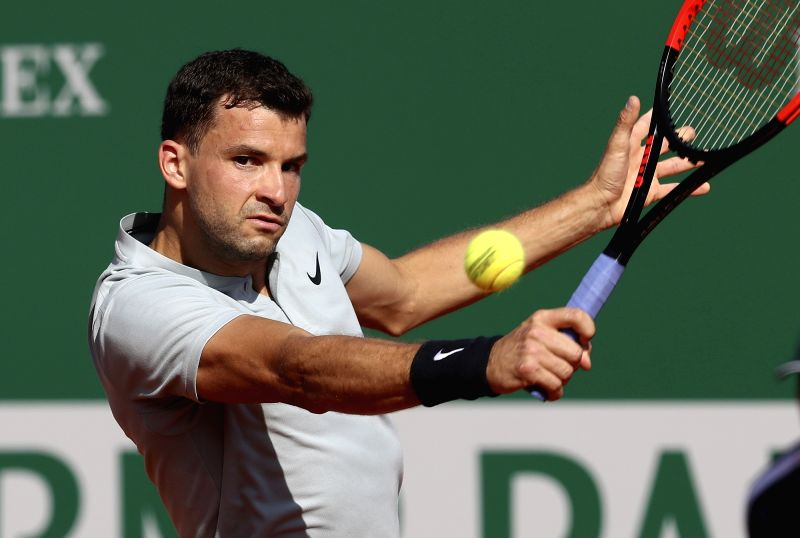 ROQUEBRUNE-CAP-Grigor Dimitrov of Bulgaria returns the ball to Pierre-Hugues Herbert of France during the second round match of 2018 Monte-Carlo Masters in ...