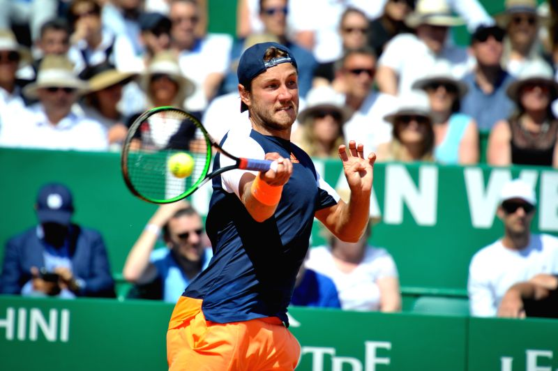 ROQUEBRUNE-CAP-Lucas Pouille of France returns the ball to Albert Ramos-Vinolas of Spain during their semifinal match at the ATP World Tour Masters Monte Carlo in ...