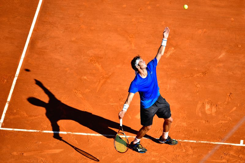 ROQUEBRUNE-CAP-Malek Jaziri of Tunisia serves during the first round match of 2017 Monte-Carlo Masters against Gilles Simon of France in Roquebrune-Cap-Martin, ...