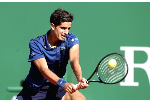 ROQUEBRUNE-CAP-Pierre-Hugues Herbert of France returns the ball to Grigor Dimitrov of Bulgaria during the second round match of 2018 Monte-Carlo Masters in ...