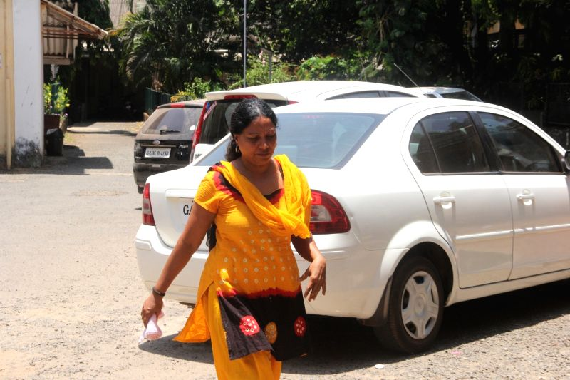 Rosy Feroor, the third accused in the rape and human trafficking of a minor involving a sitting Goa legislator arrives to surrender before the Crime Branch in Panaji on May 7, 2016.